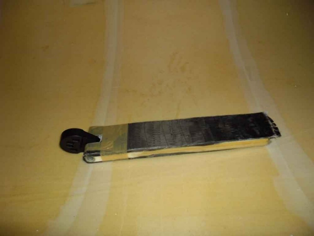 chainplate with peel ply and tape.jpg