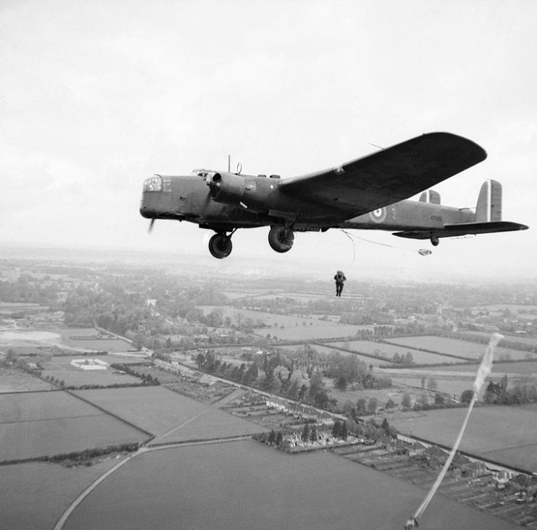 779px-Parachute_troops_jump_from_a_Whitley_bomber_during_a_demonstration_for_the_King_near_Windsor,_25_May_1941._H9955.jpg