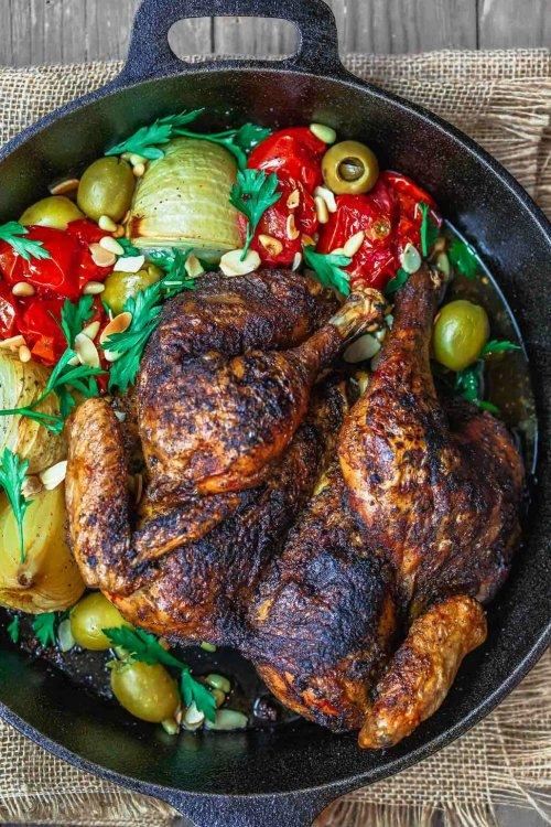 Spatchcocked chicken done Mediterranean-style in a cast iron skillet.jpg