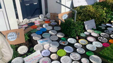 empty-plates-left-outside-tory-office-in-protest-of-free-school-meals-vote.png