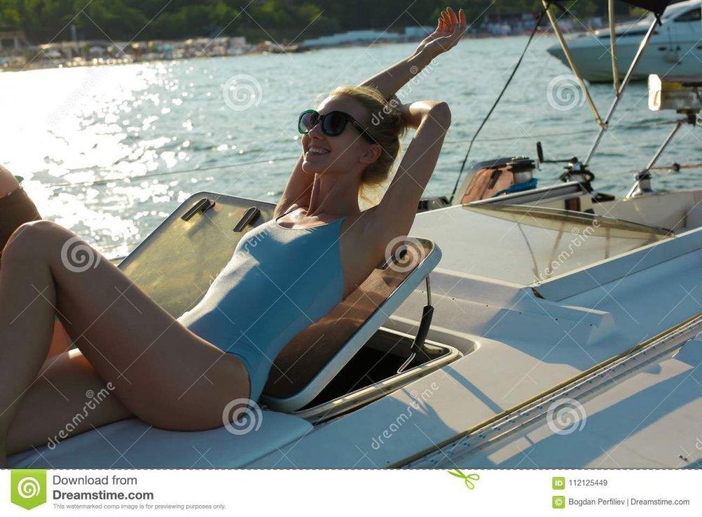 slim-beautiful-smiling-lady-wearing-blue-one-piece-swimsuit-sunglasses-sunbathing-deck-yacht-young-woman-112125449.thumb.jpg.befbea630759b5e89e1f220596b2734f.jpg