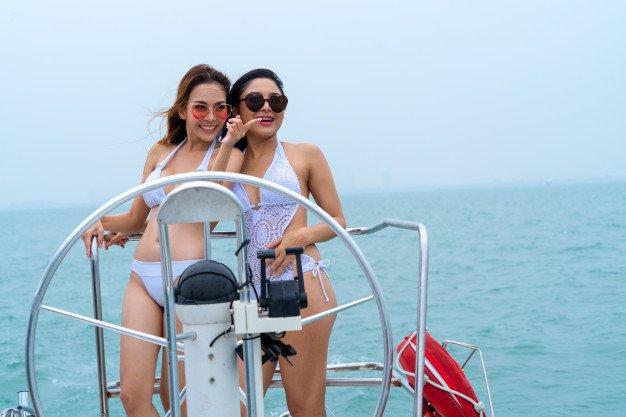 bikini-sexy-girl-stand-dance-with-driver-hand-steering-wheel-boat-yacht-with-background-sea-sky_28976-866.jpg