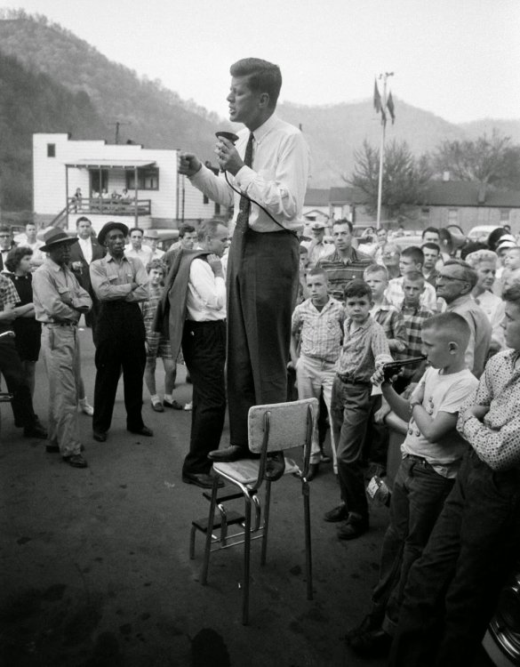 John+F.+Kennedy+campaigns+in+rural+West+Virginia,+precariously+perched+on+a+high-chair+to+deliver+his+speech.+1960.jpg
