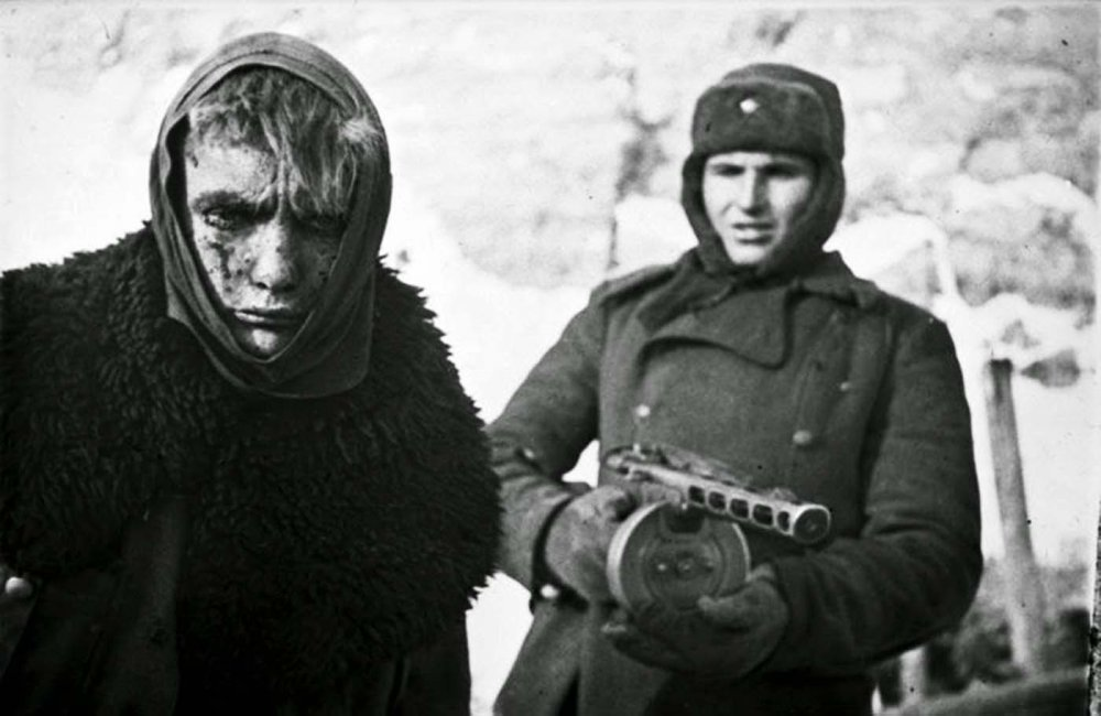 A German prisoner of war escorted by a Soviet soldier, Stalingrad, 1943.jpg