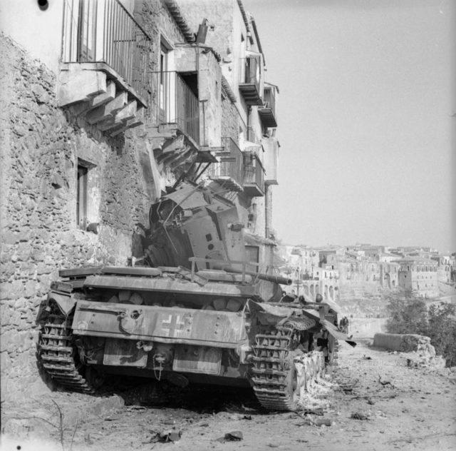 a-german-mk-iii-tank-knocked-out-during-the-fierce-street-fighting-in-centuripe-iwm-na-5389.jpg