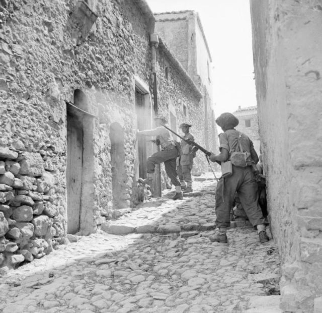 men-of-the-6th-inniskillings-38th-irish-brigade-searching-houses-during-mopping-up-operations-in-centuripe-sicily-august-1943-iwm-na-5388.jpg